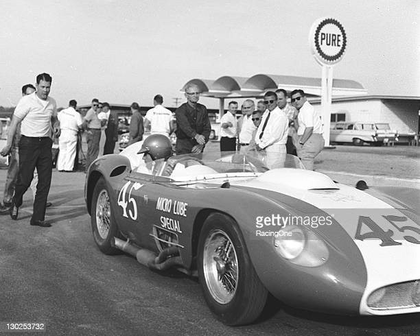 Lloyd Ruby watches as Carroll Shelby prepares to take a Maserati 300S 3052/Corvette out for practice laps in preparation for the 1000km of Daytona...