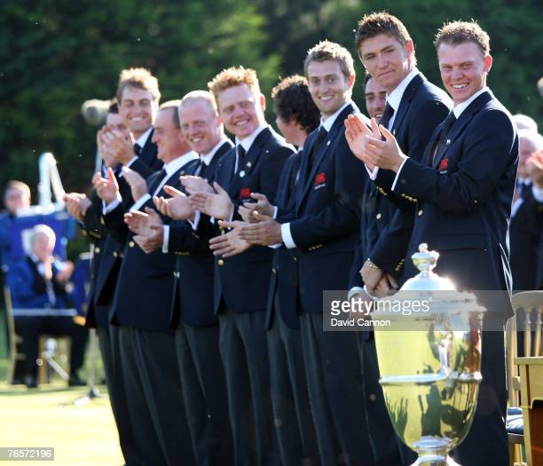 Lloyd Saltman of Scotland and of the Great Britain and Ireland team with Daniel Willett of England and the Walker Cup during the flag raising...