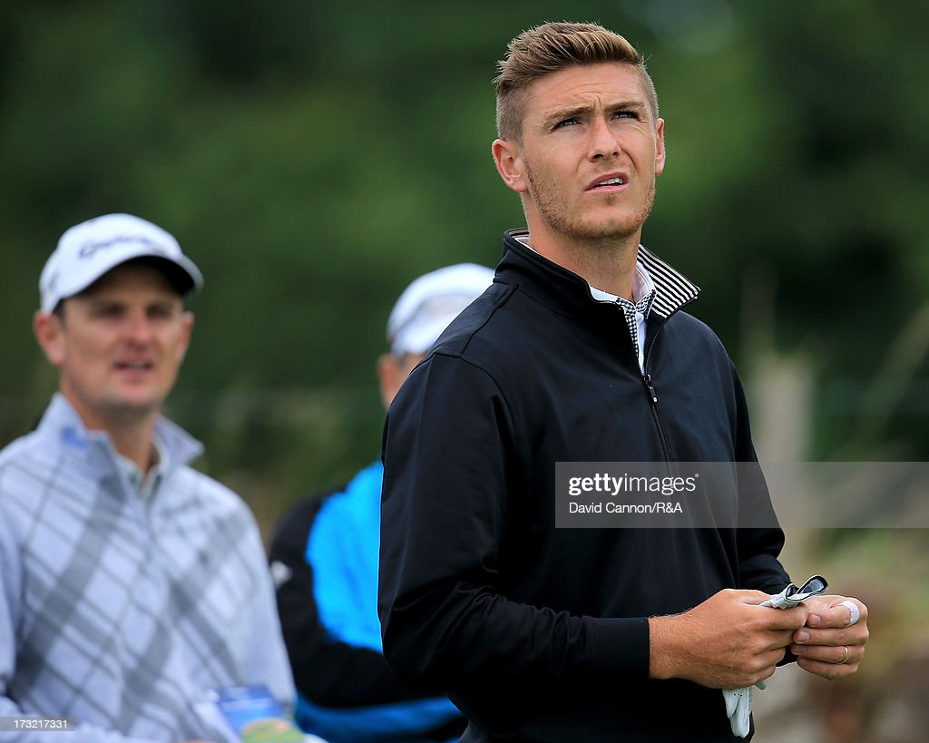 Lloyd Saltman of Scotland is watched by the US Open Champion Justin Rose of England during a practice round as a preview for the 2013 Open Championship at Muirfield on July 10, 2013 in Gullane, Scotland.