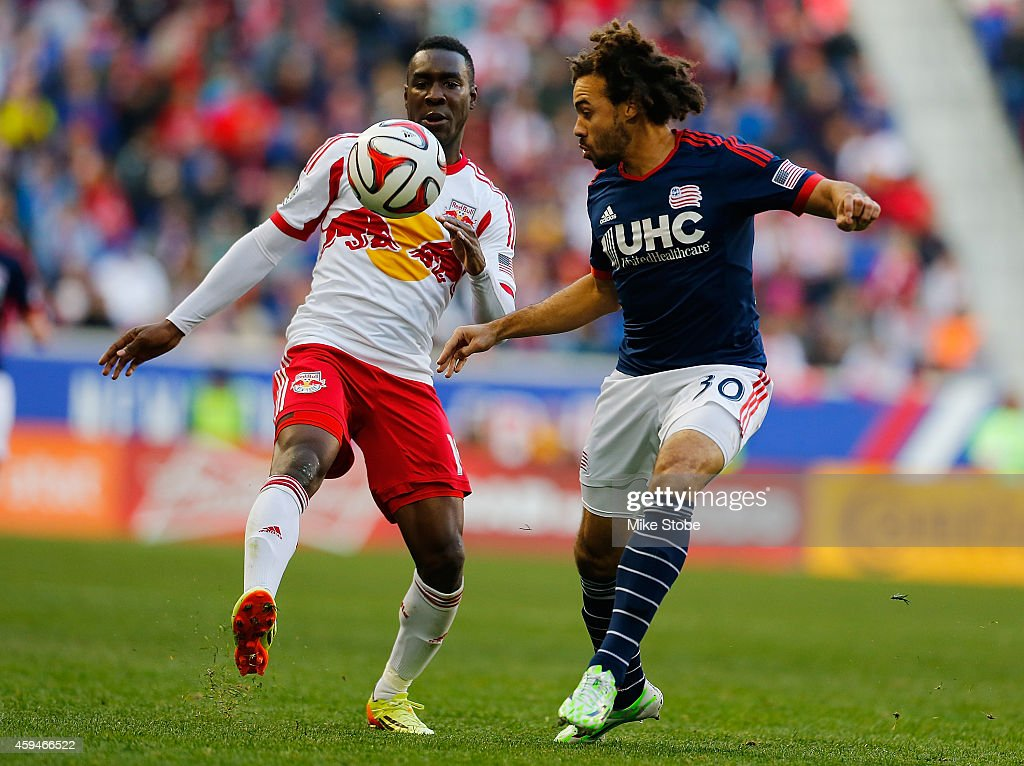 Lloyd Sam #10 of New York Red Bulls and Kevin Alston #30 of New England Revolution vie for the ball during the Eastern Conference Final - Leg 1 at Red Bull Arena on November 23, 2014 in Harrison, New Jersey. Revolution defeated the Red Bulls 2-1.
