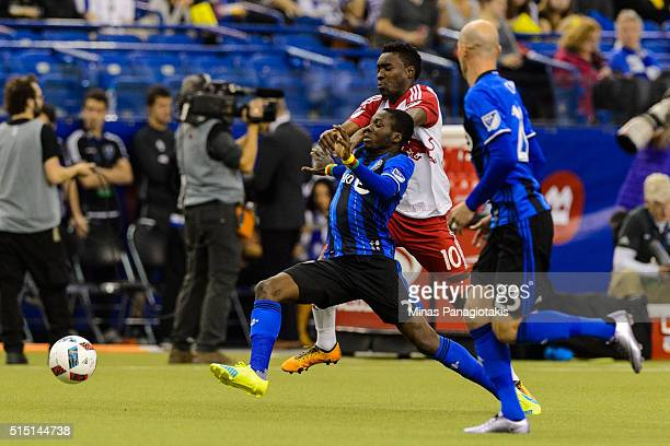 Lloyd Sam of the New York Red Bulls challenges Ambroise Oyongo of the Montreal Impact during the MLS game at the Olympic Stadium on March 12 2016 in...