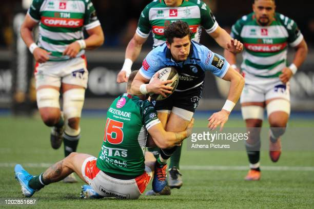 Lloyd Williams of Cardiff Blues is tackled by Luca Sperandio of Benetton Treviso during the Guinness Pro14 Round 12 match between the Cardiff Blues...