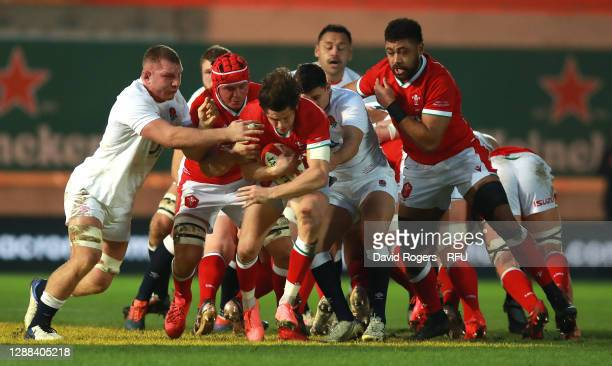Lloyd Williams of Wales holds on to the ball as Ben Youngs and Sam Underhill tackle during the Quilter International match between Wales and England...