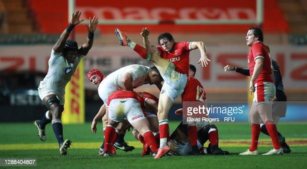 Lloyd Williams of Wales kicks the ball past Maro Itoje during the Quilter International match between Wales and England as part of the Autumn Nations...