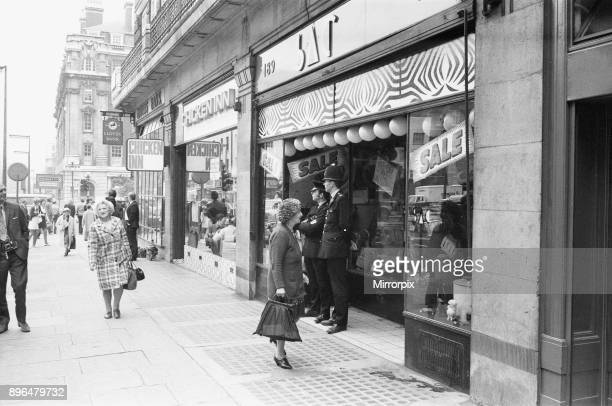 Lloyds Bank on the corner of Baker Street and Marylebone Road, London. Our Picture Shows: Uniformed policemen guarding the enterance to Le Sac...