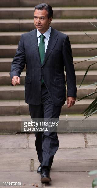 Lloyds Banking Group's chief executive Antonio HortaOsorio prepares to pose for photographs outside the Lloyds Banking Group headquarters in central...