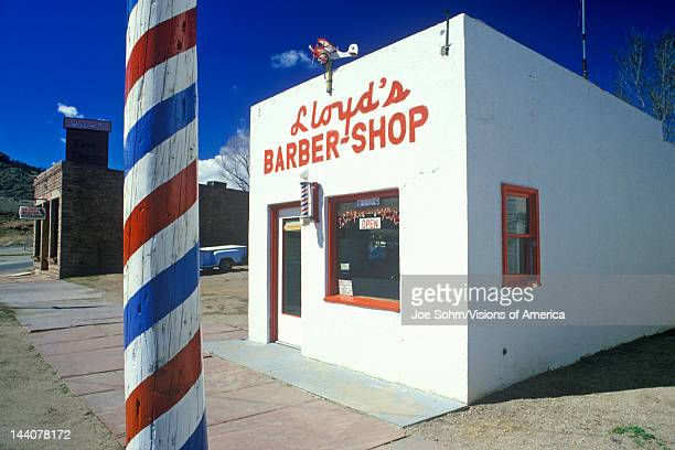 Lloyd's Barber shop with barber pole in foreground Lyons Colorado