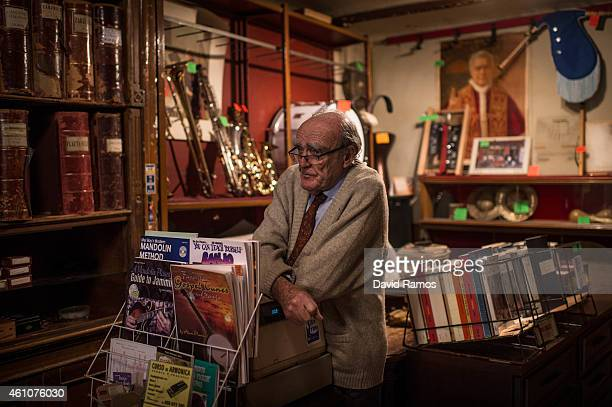 Lluis Castello owner of Musical Emporium looks on during his last day open to the public on January 5 2015 in Barcelona Spain Musical Emporium is a...