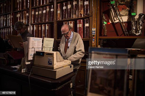 Lluis Castello owner of Musical Emporium works on his cash register during his last day open to the public on January 5 2015 in Barcelona Spain...