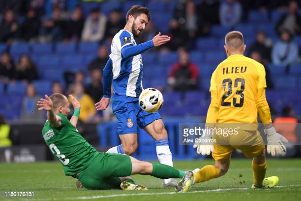 Lluis Lopez of Espanyol scores his team's sixth goal past Plamen Iliev and Anton Nedyalkov of Ludogorets during the UEFA Europa League group H match...