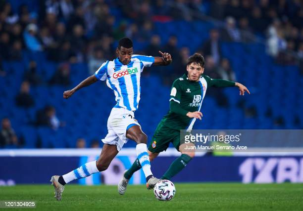 Lluis Lopez of RCD Espanyol duels for the ball with Alexander Isak of Real Sociedad during the Copa del Rey Round of 32 match between Real Sociedad...