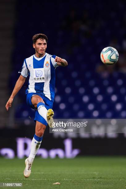 Lluis Lopez of RCD Espanyol plays the ball during the UEFA Europa League Play Off match between Espanyol and Zoryan Luhansk at RCDE Stadium on August...