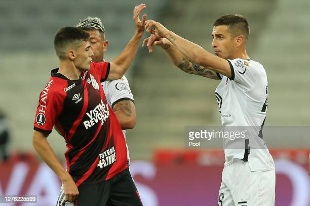 Léo Cittadini of Athletico Paranaense struggles with Javier Parraguez of ColoColoduring a group C match of Copa CONMEBOL Libertadores 2020 between...