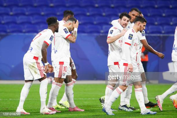 Léo DUBOIS of Lyon and Houssem AOUAR of Lyon and MARCELO of Lyon during the Ligue 1 soccer match between Olympique Lyonnais and Strasbourg at...
