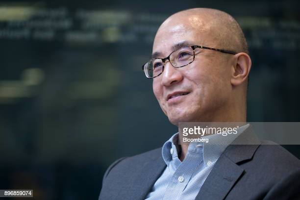Lo Kai Shui founder of Sun Fook Kong Group Ltd listens during an interview in Hong Kong China on Thursday July 20 2017 Sun Fook Kong Group is a real...