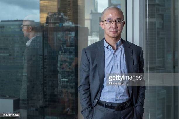 Lo Kai Shui founder of Sun Fook Kong Group Ltd poses for a photograph in Hong Kong China on Thursday July 20 2017 Sun Fook Kong Group is a real...