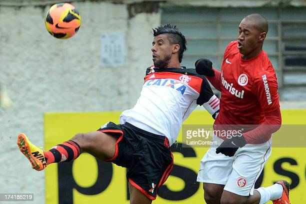 Léo Moura of Flamengo fights for the ball with Fabrício of Internacional during a match between Flamengo and Internacional as part of the Brazilian...