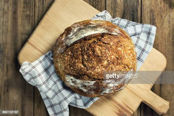 load of bread on cutting board - loaf of bread stock pictures, royalty-free photos & images