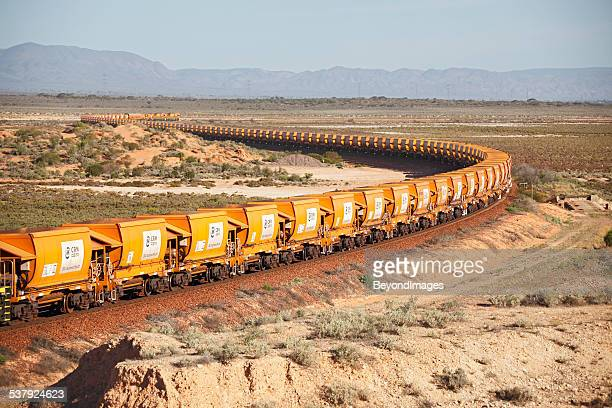 loaded arrium iron ore train snaking through outback - iron ore stock photos and pictures