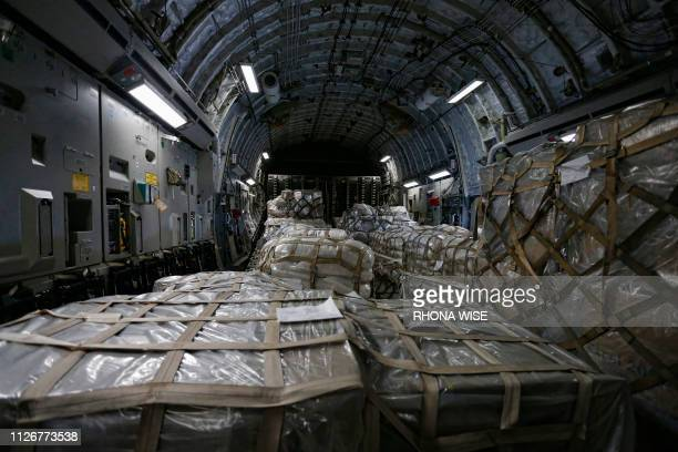 TOPSHOT A loaded C17 cargo plane with food water and medicine for a humanitarian mission to Colombia to aid Venezuelans is seen at the Homestead Air...