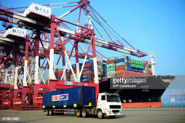 A loaded container ship is seen at a port in Qingdao eastern China's Shandong province on July 13 2017 China's exports rose a forecastbeating 113...