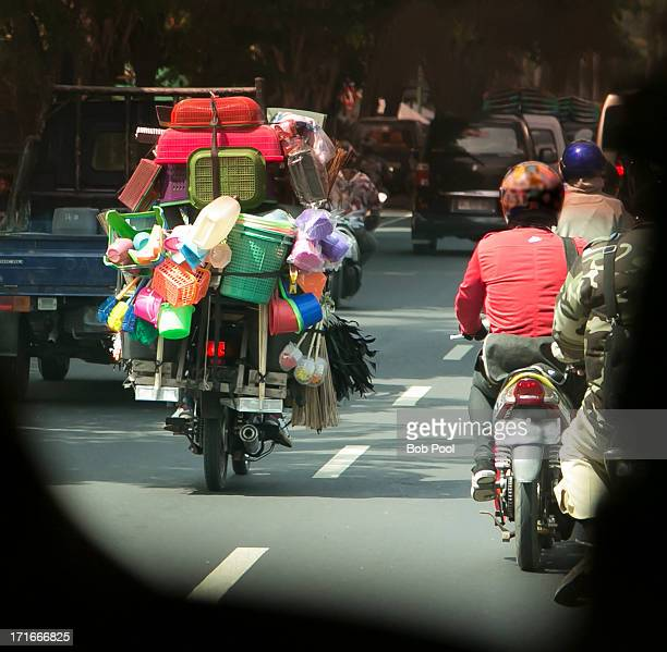 Loaded motorcycle on Highway, Indonesia