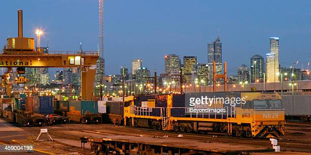 Loaded Pacific National freight train at night in city terminal
