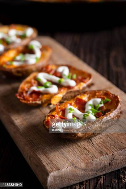 loaded potato skins - prepared potato stock pictures, royalty-free photos & images