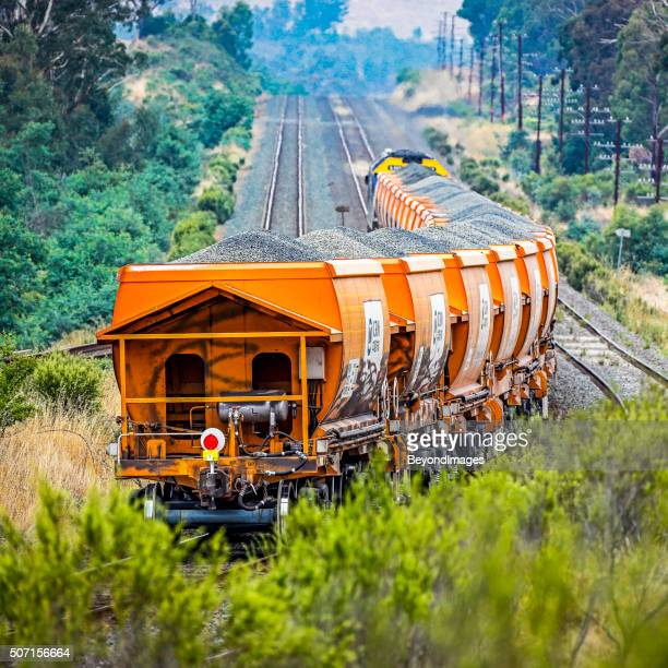 Loaded stone train with graffiti vandalism in rural countryside