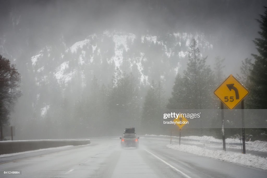 Loaded up family car on snowy Pacific Northwest road trip : Stock Photo