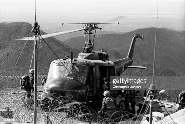 Loaded with equipment US Army soldiers board a Bell UH1 Iroquois helicopter better known as a Huey at Fire Support Base Ripcord Republic of Vietnam...
