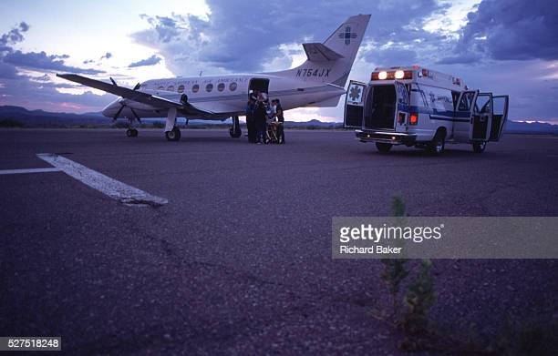 Loading a patient bound for hospital for treatment, on to a British Aerospace BAe-3101 Jetstream 31, an air ambulance on the runway at San Carlos...