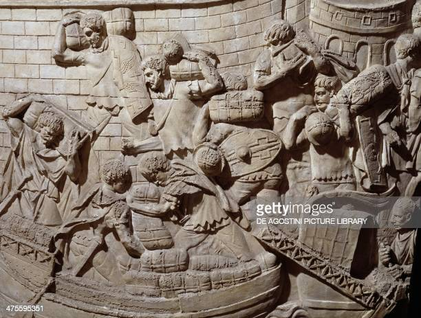 Loading arms and supplies at a riverside harbour cast of a basrelief scene from Trajan's Column in Rome Italy Roman civilisation 2nd century AD