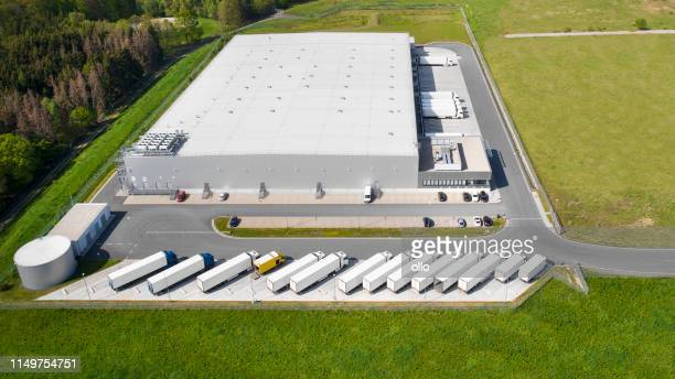 loading bay, truck parking lot, industrial building, logistics - aerial view - roof stock pictures, royalty-free photos & images