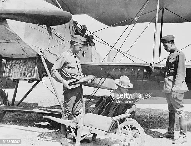 Loading bomber with bombs at an American aviation school. World War I.