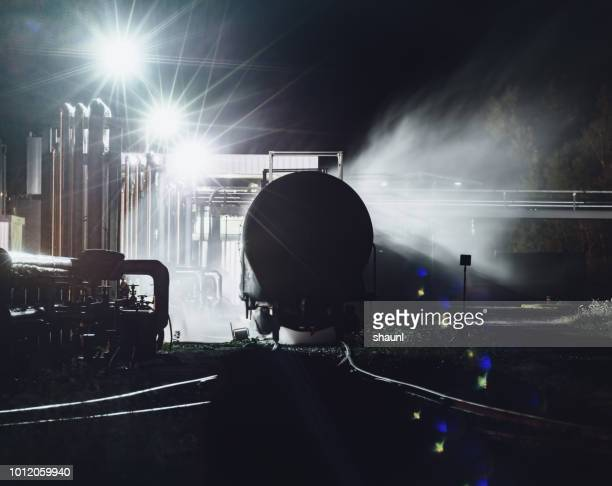 loading byproduct tank cars - gas tank stock photos and pictures