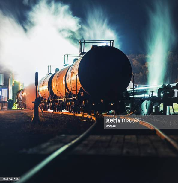 loading byproduct tank cars - storage tank stock photos and pictures