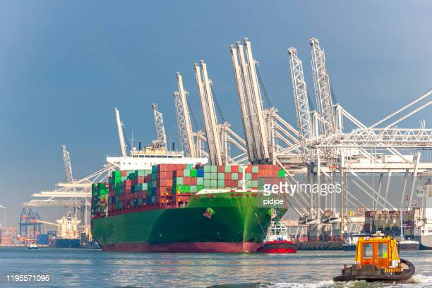 loading cargo container ship in commercial dock - rotterdam stock pictures, royalty-free photos & images