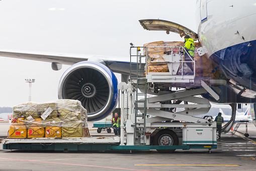 Loading cargo into the aircraft before departure in Domodedovo airport in Moscow Russia 1047540990