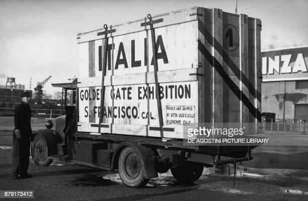 Loading cargo onto the SS Rex travelling to San Francisco for the Golden Gate International Exposition December 1 Genoa port Italy 20th century