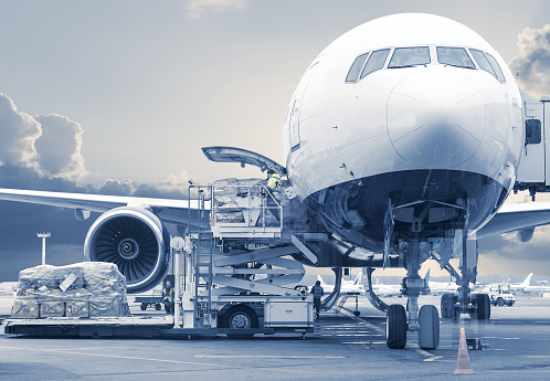 loading cargo picture in a blue toning 1027833750