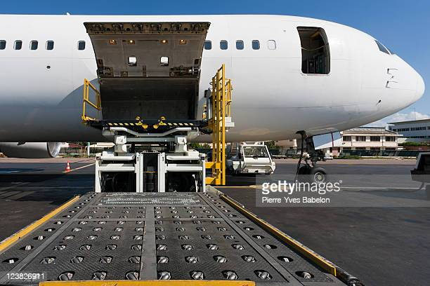 loading cargo plane - cargo airplane stock photos and pictures