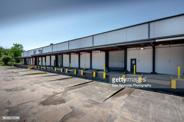 loading dock for warehouse - roller shutter stock pictures, royalty-free photos & images