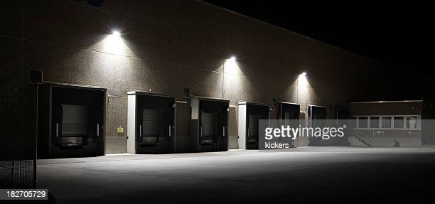 loading docks at warehouse (hdr) - stadium lights stock photos and pictures