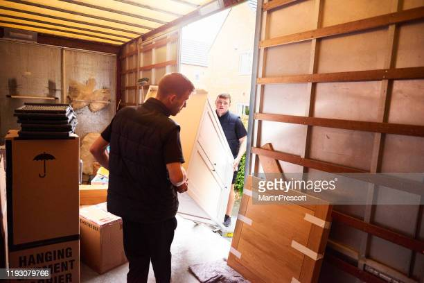 loading furniture into removal truck - furniture stock pictures, royalty-free photos & images