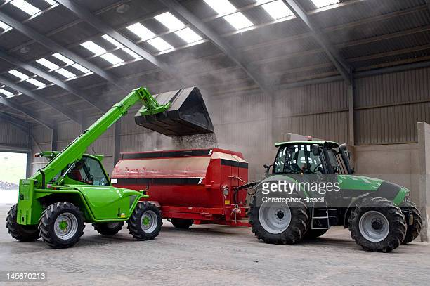 loading grain into mixer - agricultural machinery stock pictures, royalty-free photos & images