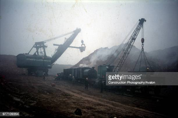 Loading iron ore into wagons to be conveyed to Corby Steelworks Northamptonshire