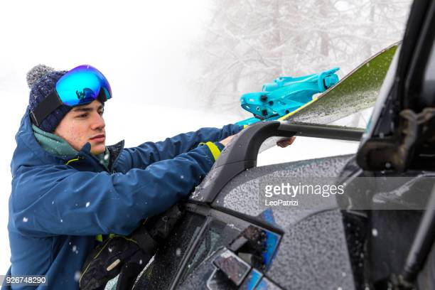 Loading the car after a skiing day in mountain