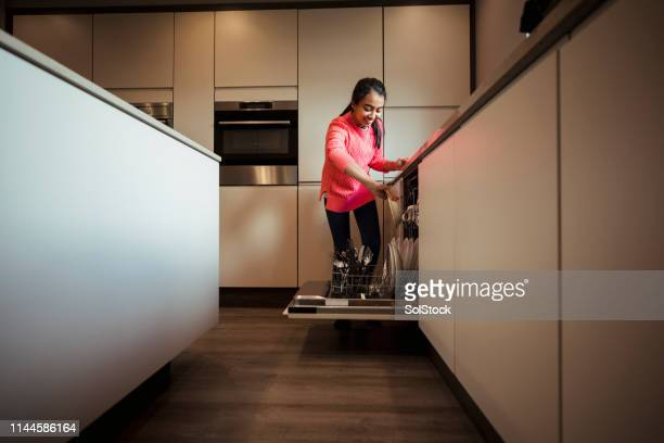 loading the dishwasher - individual event stock pictures, royalty-free photos & images