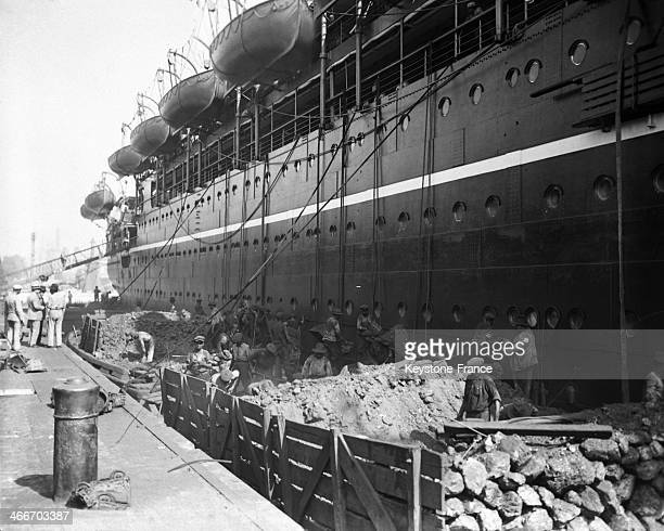 Loading up a ship in the harbour in 1928 in Marseilles France
